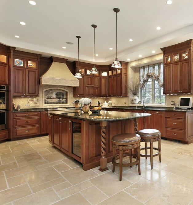 Gorgeous Cabinetry Is Offset By Creamy Walls And Subtly Green Granite  Counters. The Bright Floor