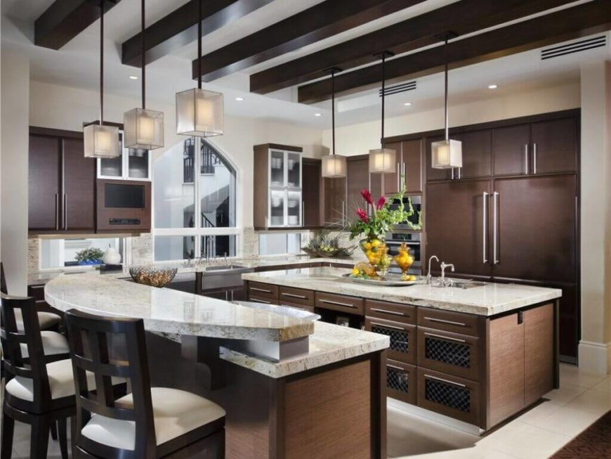 This is another enormous luxury kitchen that features two islands in  addition to spacious countertops.