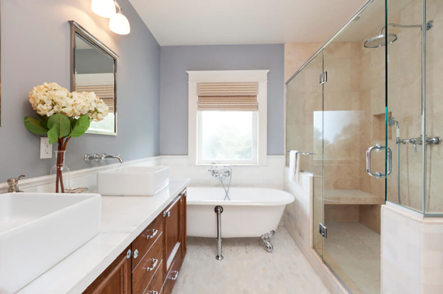 a large glass wall shower sits to the side in this bathroom taking up a - Clawfoot Tub Bathroom Designs
