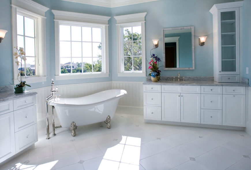 the corner of this bathroom is well lit by natural light flooding through the three paned - Clawfoot Tub Bathroom Designs