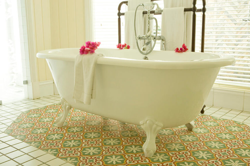 This Large Clawfoot Tub Sits Centered On A Patch Of Accent Tiles With A Different