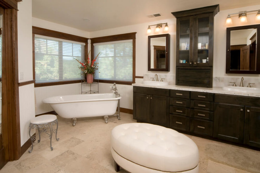 this spacious bathroom features a large countertop with two sinks and a space in between for - Clawfoot Tub Bathroom Designs