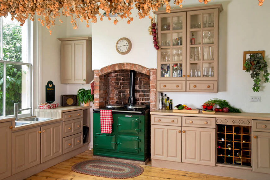 Hereu0027s A Lovely Rustic Kitchen With Beige Cabinetry, A Vintage Stove With A  Brick Chimney