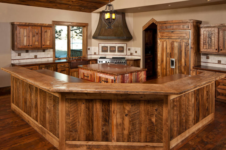 A beautiful rustic wood kitchen with multi tonal wood and rich texture  throughout.The arching