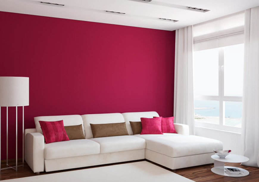 This Living Room Is Simple Yet Vibrant The Bright Pink Accent Pillows Contrast The