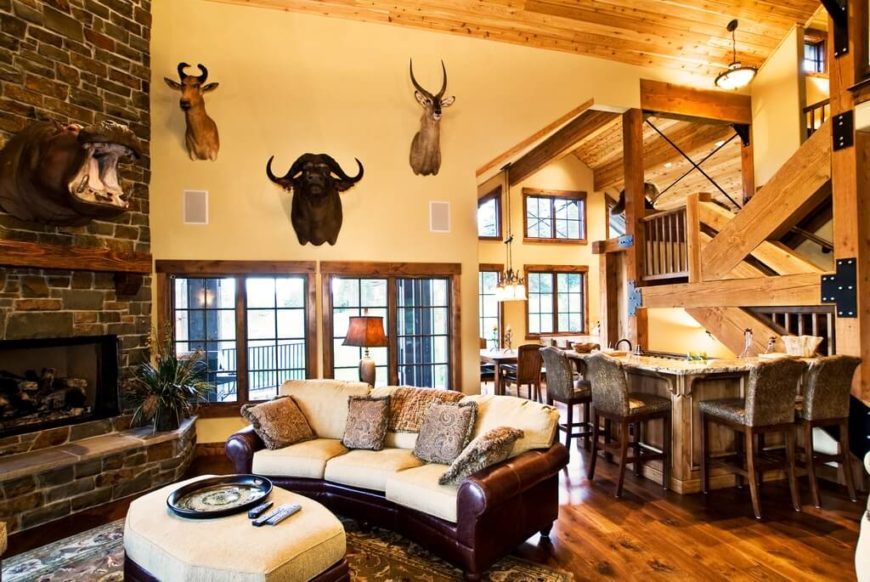 This Large Living Room Features A Rustic Country Hunter Design. With Rich  Dark Leather Furniture