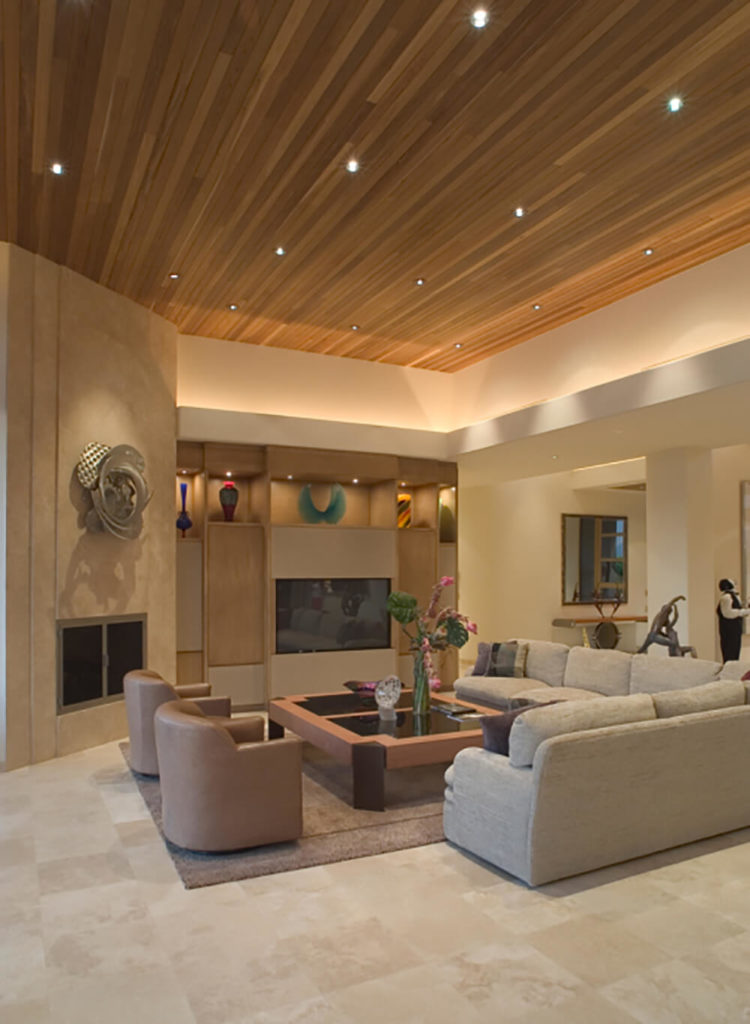 the large couch wraps around the edge of this living room and acts as a - Decorating A Large Living Room Wall