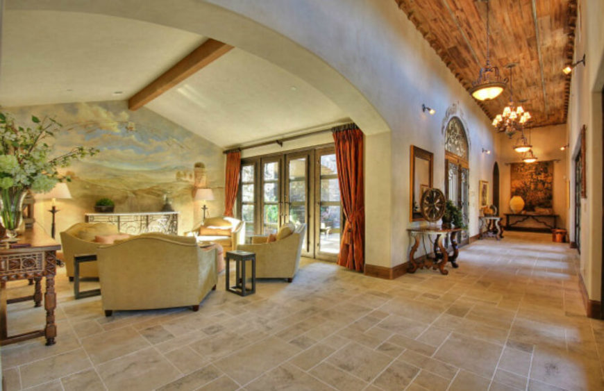 This Grand Living Room Opens Up Completely To A Large Hallway And Also Features A