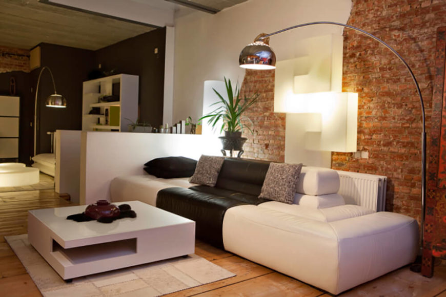 a unique space with modern furniture and low calm lighting this living room wall - Brick Living Room Decor