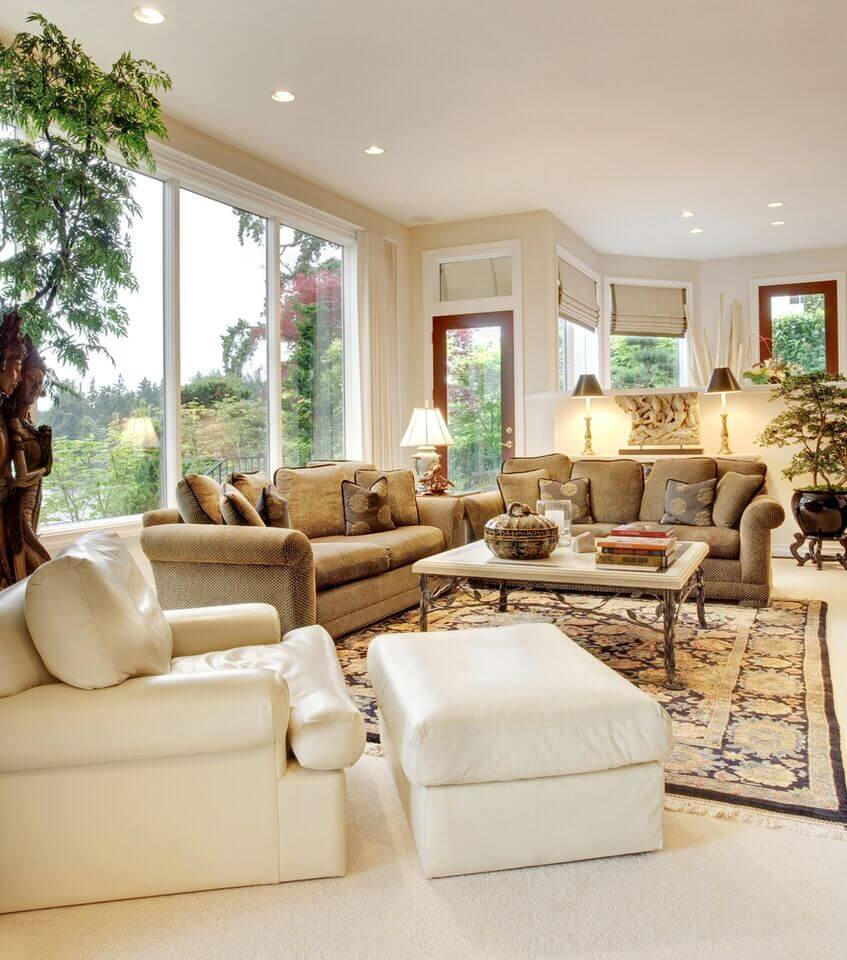 White leather living room furniture - In This Traditionally Appointed Living Room We See Both Textural Brown Sofas And A Bold