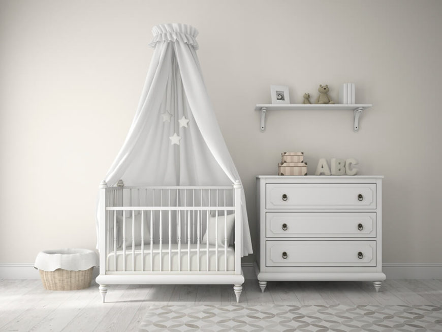 A variation of the white nursery featured earlier with a subtle rug over the white wood flooring and a few small neutral decorations on the dresser and shelf.