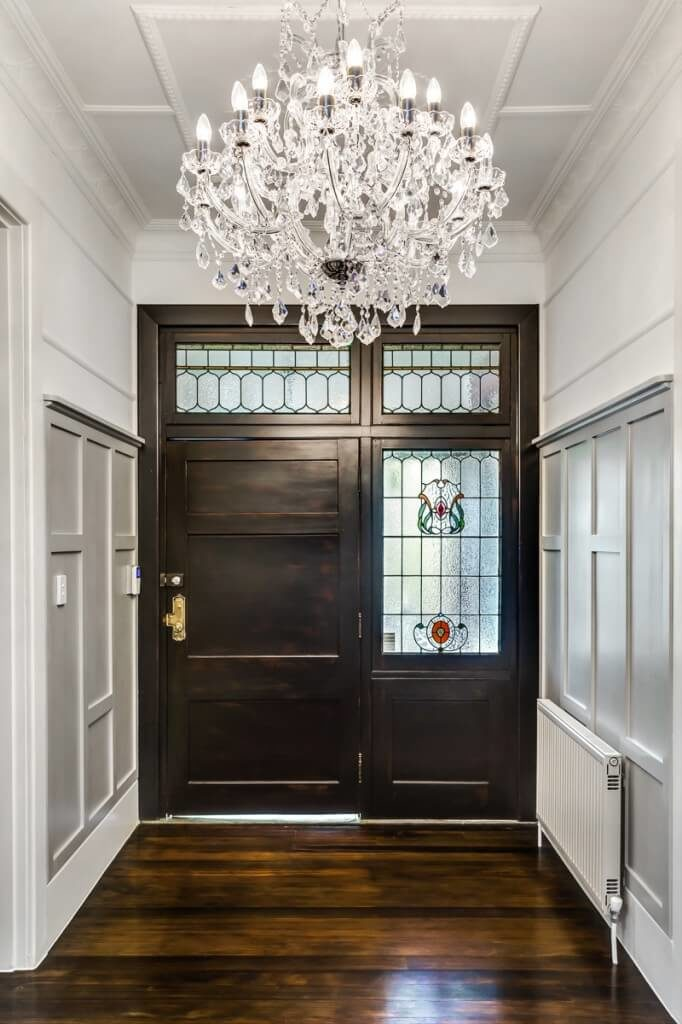 33 gorgeous foyers with wainscoting - Classic wrought iron chandeliers adding more elegance in the room ...