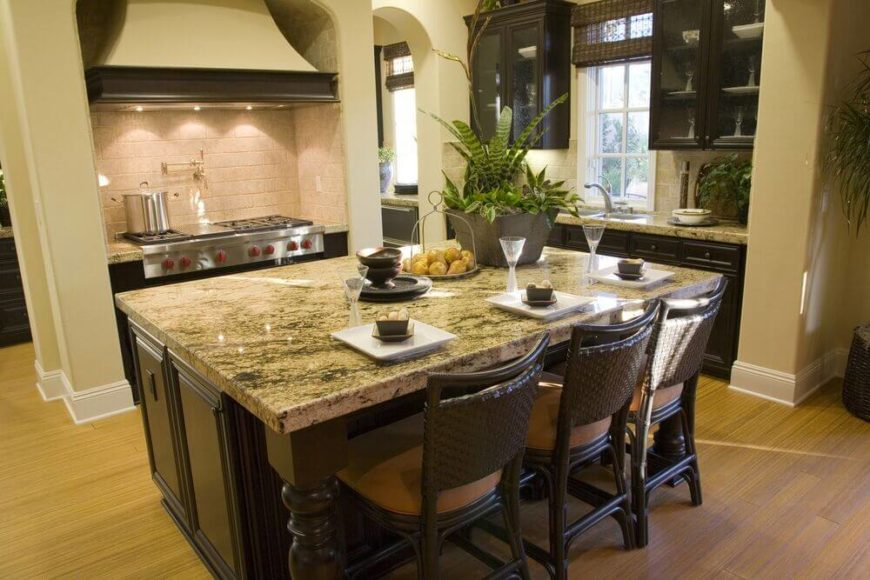 chairs continue the color scheme of the room with dark wood and neutral tan seats - Granite Kitchen Island Table