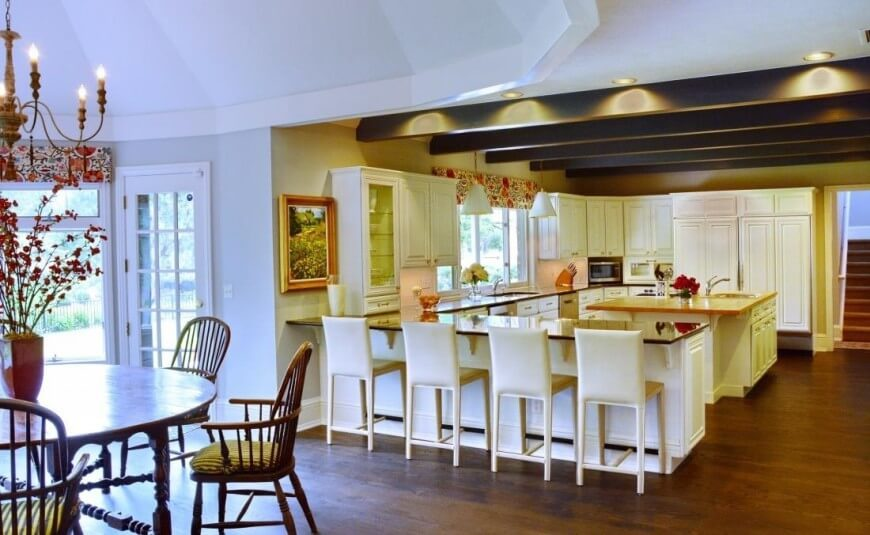 An Utterly Contemporary Kitchen With Dark Exposed Wood Beams Across The Ceiling Of Lower
