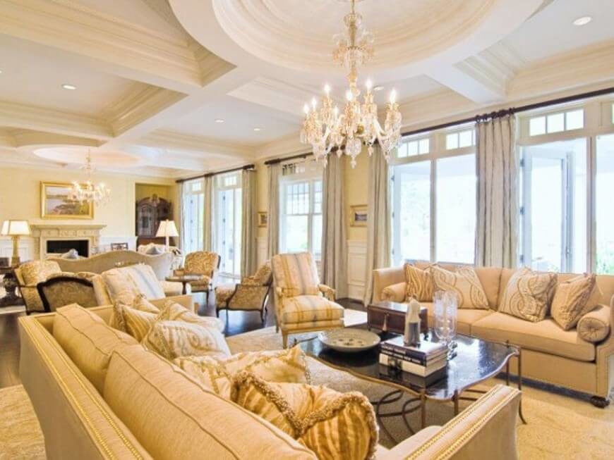 We love the way a delicately coffered ceiling can add to an already luxurious room. When the room is already flush with rich detail, you can only go up. This room is filled with nailhead trim seating and deep hardwood flooring.