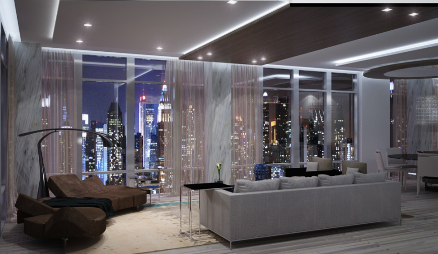 Sleek modern style meets an unfussy minimalism in this penthouse living room, overlooking a city via full height wraparound windows. The cool grey tones of the room are matched with rich chocolate brown on a unique sectional at left, while a traditional sofa and pair of club chairs faces the exterior view.