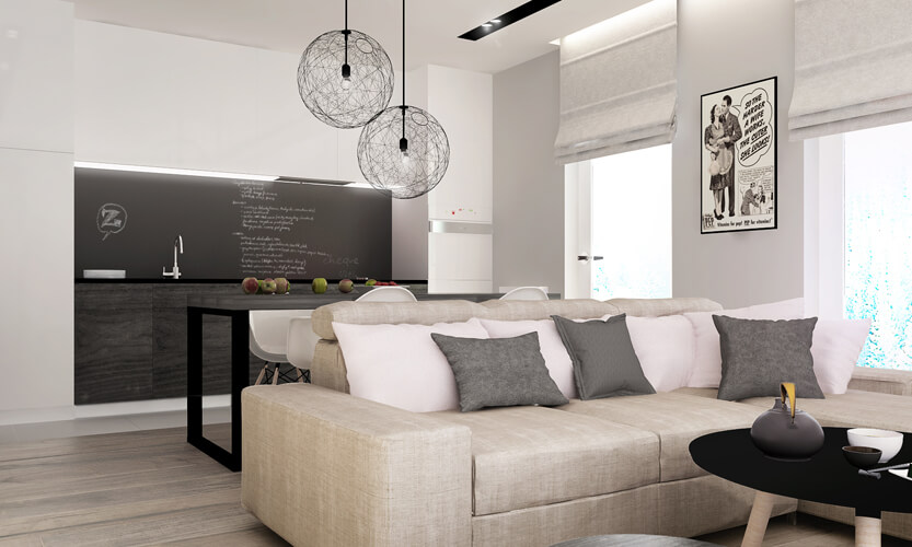 Bright whites can really expand the sense of size in a living room, and this modern space takes full advantage, with a light beige sofa at center. The open-plan space is shared with a large grey dining table and a kitchen with chalkboard backsplash.