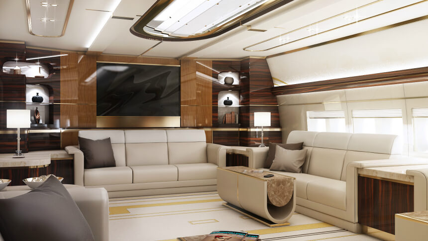 This luxurious space is actually inside of a converted jumbo jet, transformed by ultra-modern sofas and sleek wood paneling into a home away from home. We love the rich details including gold trim and intricate lighting.