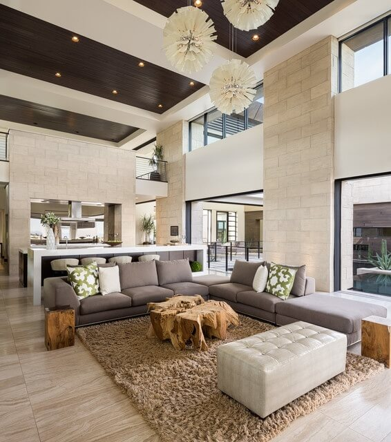 Just a little brick can go a long way. Providing archways and support beams, the example above doesn't need to dominate the entire room to leave an impression.