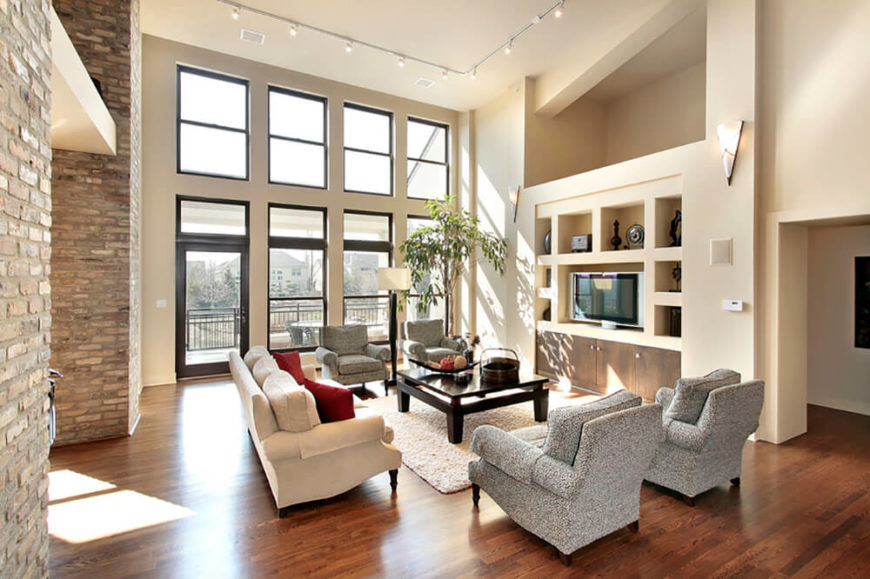 Again, the contour provided by brick helps turn a rather traditional arrangement. The brick walls in this room help provide contrast to the soft light and neutral furnishings.
