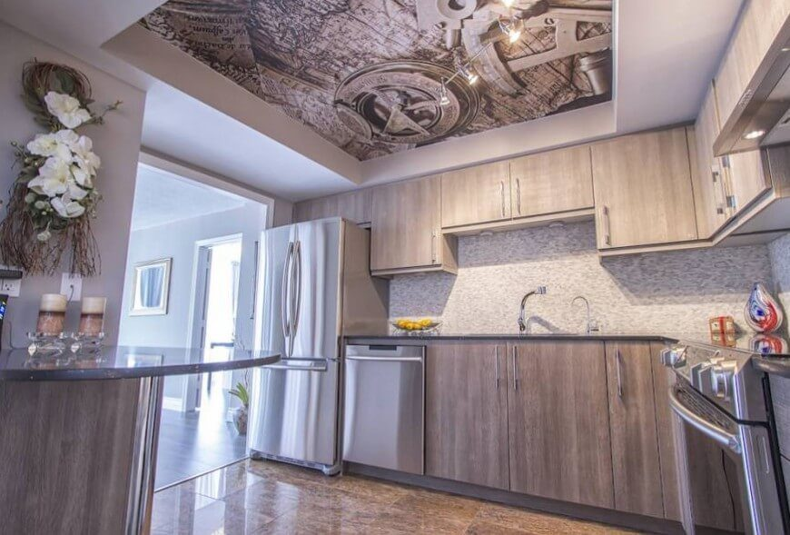 Elegant ... Stainless Steel Appliances. Beneath A Bold Art Print On The Ceiling Of  This Kitchen, We See Light Grey Part 22