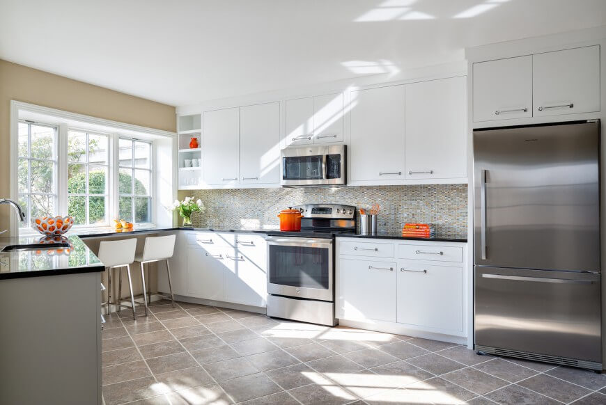 beautiful Kitchen Designs With Stainless Steel Appliances #8: Bright and open design informs this kitchen, flush with white cabinetry and stainless  steel appliances