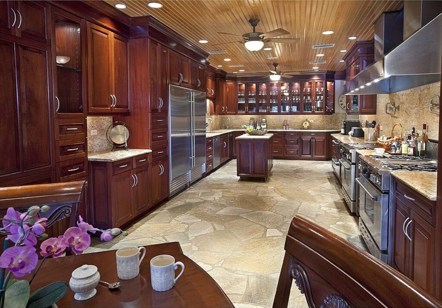of rich wood cabinetry, plus marble countertops and backsplash over ...