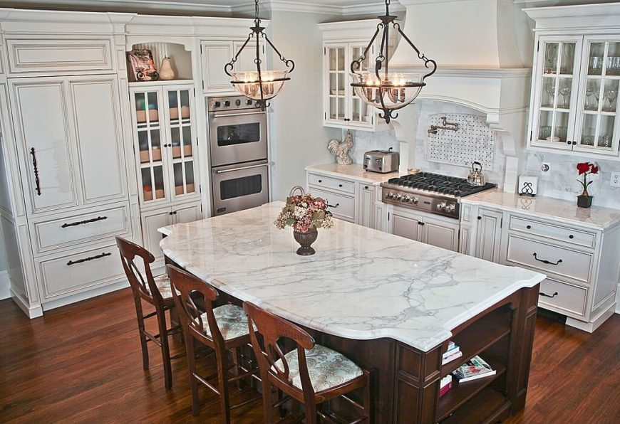 white kitchens with stainless appliances table linens wall ovens