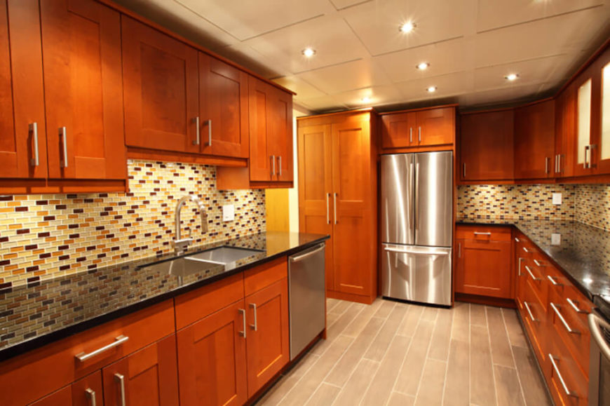 The Contemporary Shape Of The Rich Wood Cabinetry Meshes Perfectly With Stainless  Steel Appliances And A Part 57