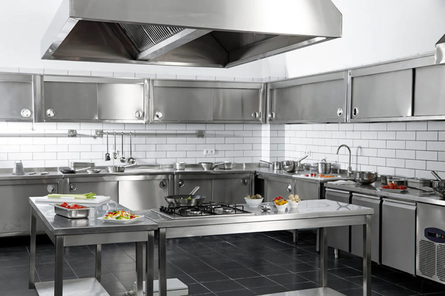 Stainless Steel Utterly Defines This Large Industrial Styled Kitchen With Rows Of Steel Cabinetry