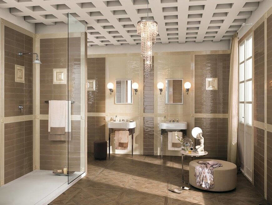 Brown tile covers the walls of this bathroom, with a lighter beige accent tiles around the floating sinks and mirrors. The lighter tiles divide the darker, giving this room a high sense of style. The floor features brown tile as well, however the pattern is different from the walls, so the color and style is not overwhelming.