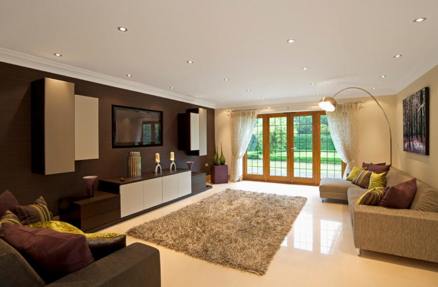 A Spacious Living Room, With Contrasting Colors On The Walls. The Wall  Behind The Part 38
