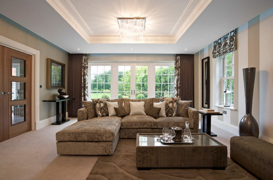 this living room features dark brown tones balanced by white wood