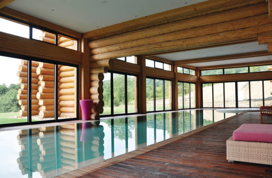 The Pool Room Is An Expansive Open Interior Space Completely Wrapped In Full Height Windows