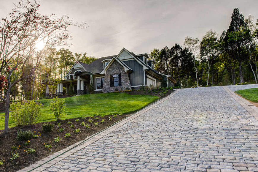 The Long Cobblestone Driveway Leads Up To The Garage That Runs Along The  Side Of The