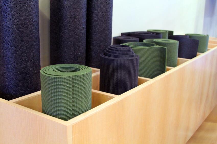 Wooden yoga mat storage
