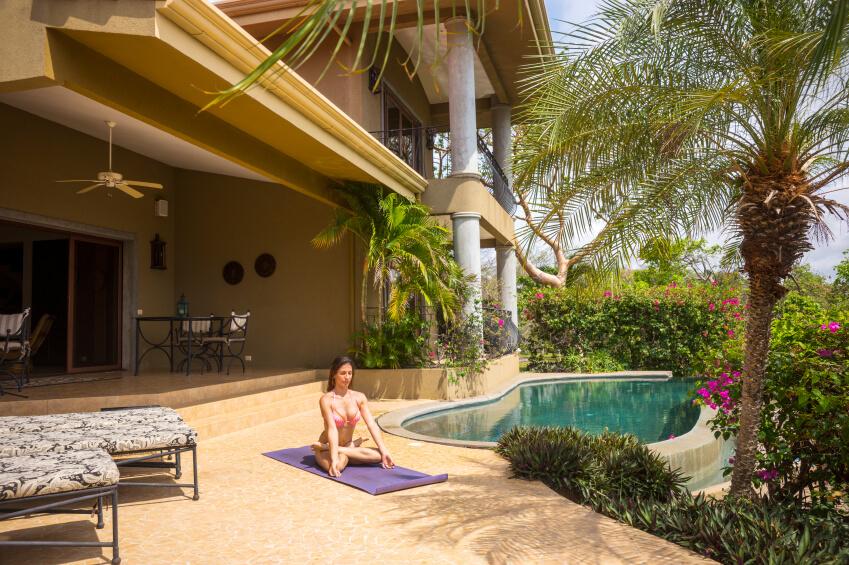 yoga on swimming pool patio