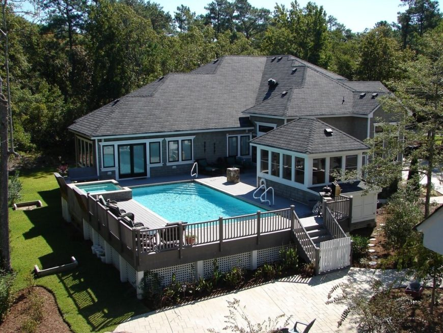 Another example of a backyard pool, but this one is elevated on a large deck, effectively sealing it off from small children or nosy neighbors.
