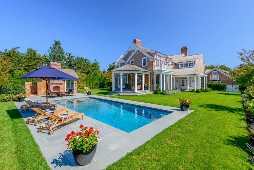 a lovely and spacious backyard with a pool surrounded by slate tiles and a small pool - Small Pool Design Ideas