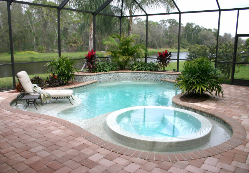 "A beautiful, if small pool with shallow ""sandbar"" areas where patio furniture can be placed. The pool is inside a warm, greenhouse like structure that allows swimmers to still view the rich vegetation and the river outside."