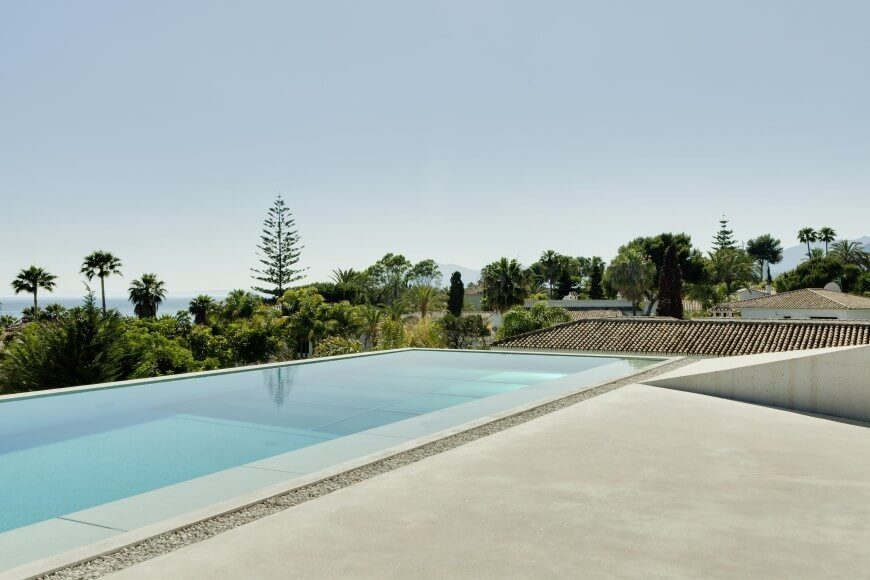 This infinity pool seems to drop right off the edge of this roof, and has a glass bottom, so guests below can see into the pool.