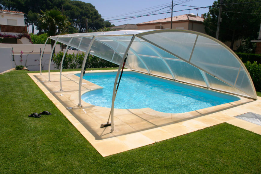 This is a more unique pool cover that is meant to fold down and create a sturdy barrier between the pool water and the environment.