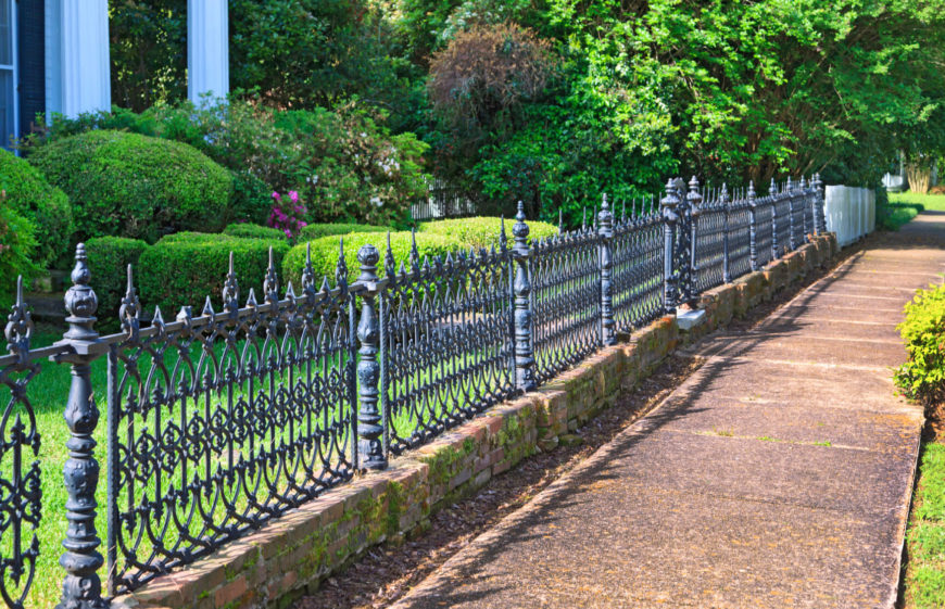 a lovely waist high wrought iron fence with detailed and attractive panels