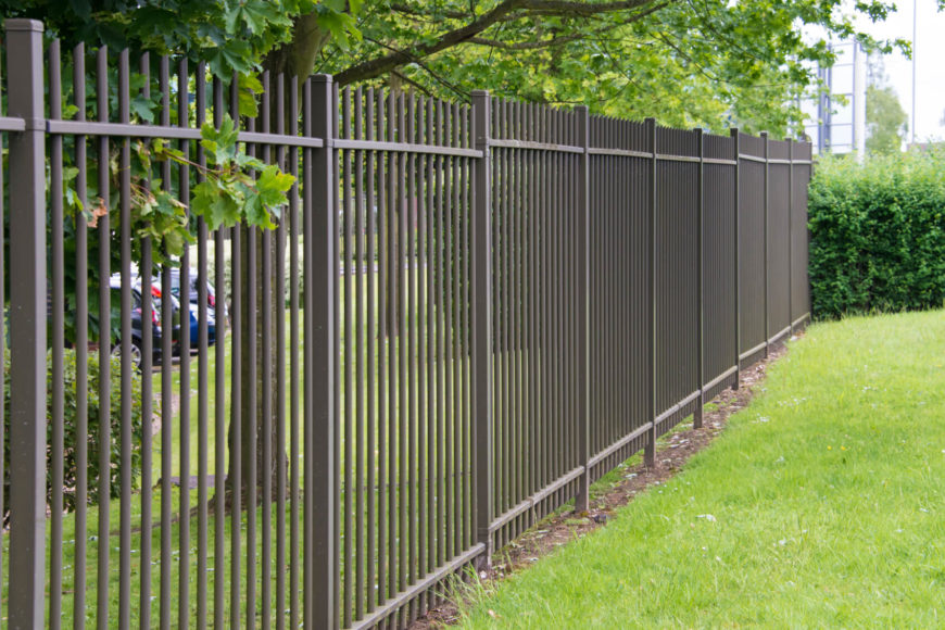 A Very Simple Wrought Iron Fence Without Any Intricate Designs Still Has A Classic Look