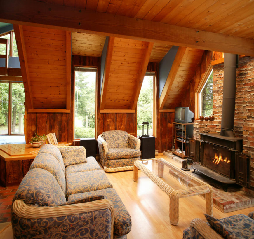 This Warm And Rustic Room Centers Around An Antique Wood Burning Stove. The  Traditional Red