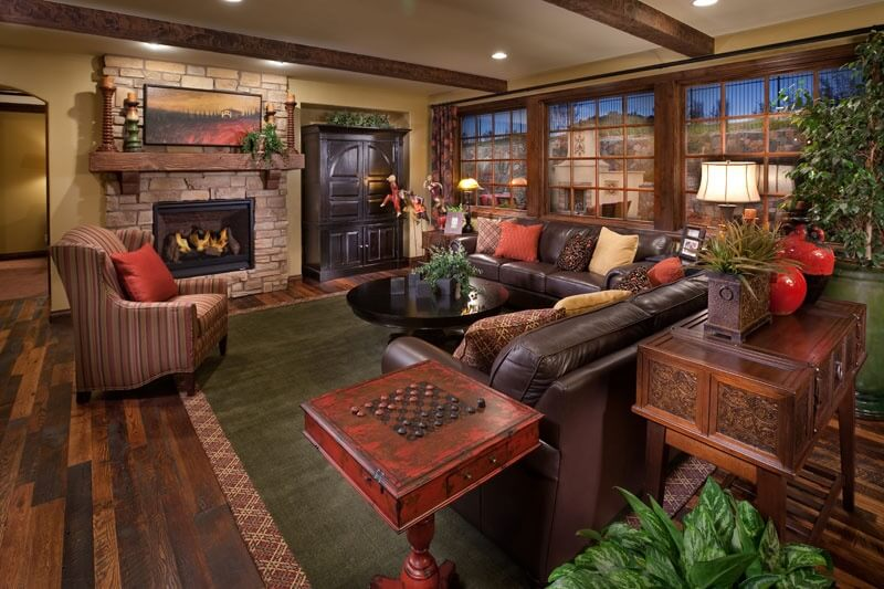 Vaulted Family Room With Fireplace And Skylights And Triple Sliders