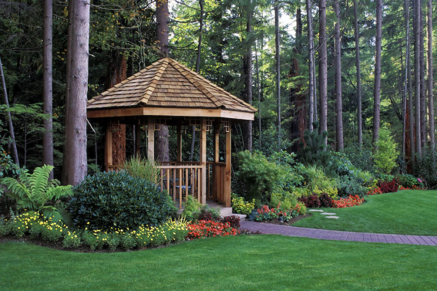 This cedar gazebo is nestled at the edge of the home's property nearest to the forest beyond. A crisp brick walkway leads up to the entrance to the gazebo.