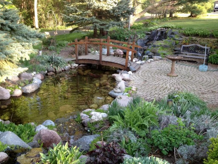 59 backyard ideas for beauty fun kids and entertaining for Garden pond design books