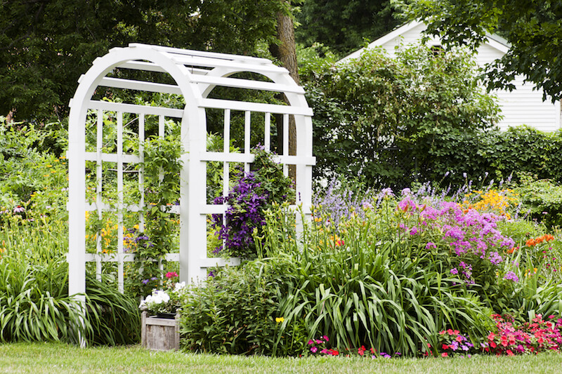 This arbor is a little thicker and has much wider lattices on either side. It's the perfect accompaniment to this thick, colorful garden.