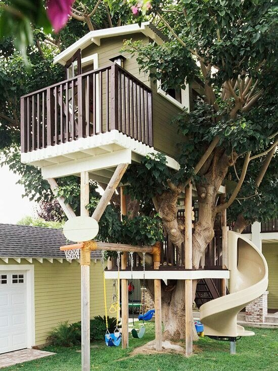 This swing set is attached to a playset and treehouse that's complete with a slide and basketball net.